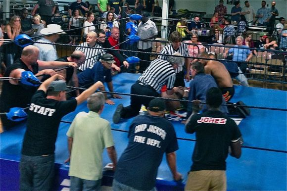 Gary Jackson is stretchered out of the ring in August after becoming a victim of  Mephisto's piledriver.  Photo: Sean Orleans