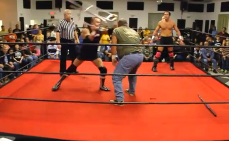 This screen capture from SICW Wrestling Explosion shows the infamous attack by Flash with the stolen walker.