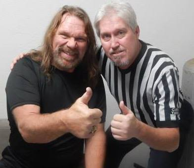 "Jim Harris (right) poses with ""Hacksaw"" Jim Duggan backstage in Illinois in 2013."