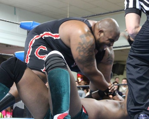 Barackus demonstrates his incredible hand strength by treating Da'Marius Jones' head like a stress ball.  Photo: Maurice Ramsey