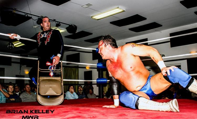 Ricky Cruz assaults Chaz Wesson with a chair on March 22 in East Carondelet.