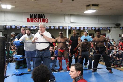 Commissioner Harris makes the matches for April 12 as wrestlers stand up to Espinosa's posse.  Photo: Maurice Ramsey