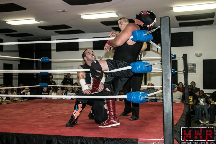 Ricky Cruz later walked out on this match with Red River Jack (right) on September 20.  Photo: Brian Kelley