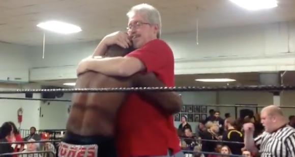 Commissioner Jim Harris embraces the sole survivor of his team after the elimination tag match Dec. 6.  Photo: Timothy Miller