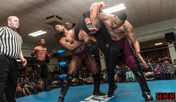 A.J. Williams and Da'Marius Jones hip toss Damion Cortess